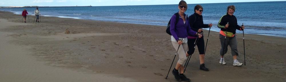 Nordic walking on beach